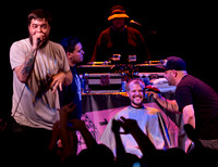 Aesop Rock rapping while dude gets terrible haircut on stage
